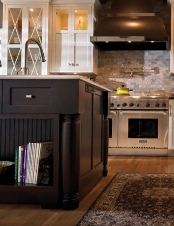 Dura Supreme Cabinetry with Power Strip on the end cap of a kitchen Island