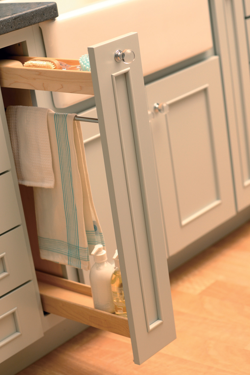 What about incorporating this thin, pull-out next to your primary clean-up sink that has a towel bar, so dish towels can dry after use (BPOF-TB or BPOC-TB) from Dura Supreme Cabinetry.