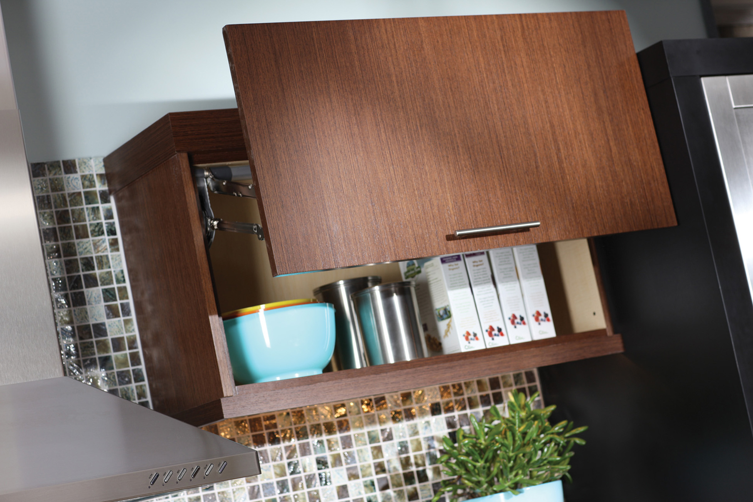 If space allows above the cabinet, a lift-door (WLD) provides full-access to upper cabinets that are hard to reach. Kitchen storage idea from Dura Supreme Cabinetry.