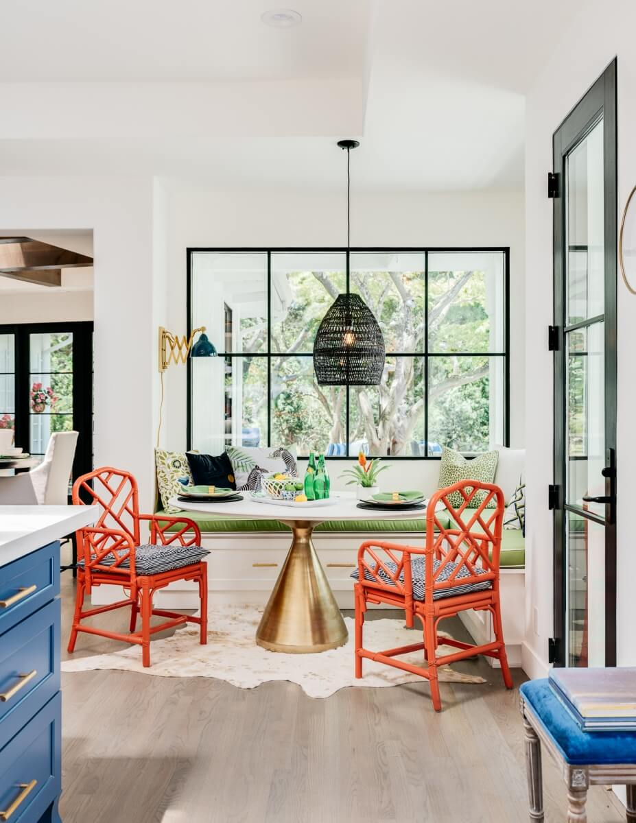 A breakfast nook seating area in the kitchen with a large pendant light.