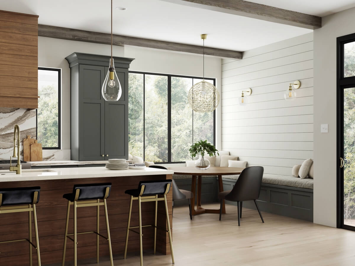 A kitchen breakfast nook with a large beautiful pendant light over the kitchen table with banquette seating with cabinetry boot bench seats.