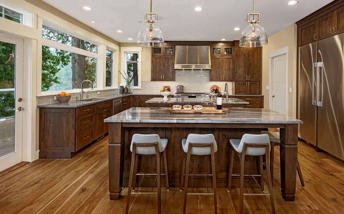 Rich stained kitchen cabinets from Dura Supreme.