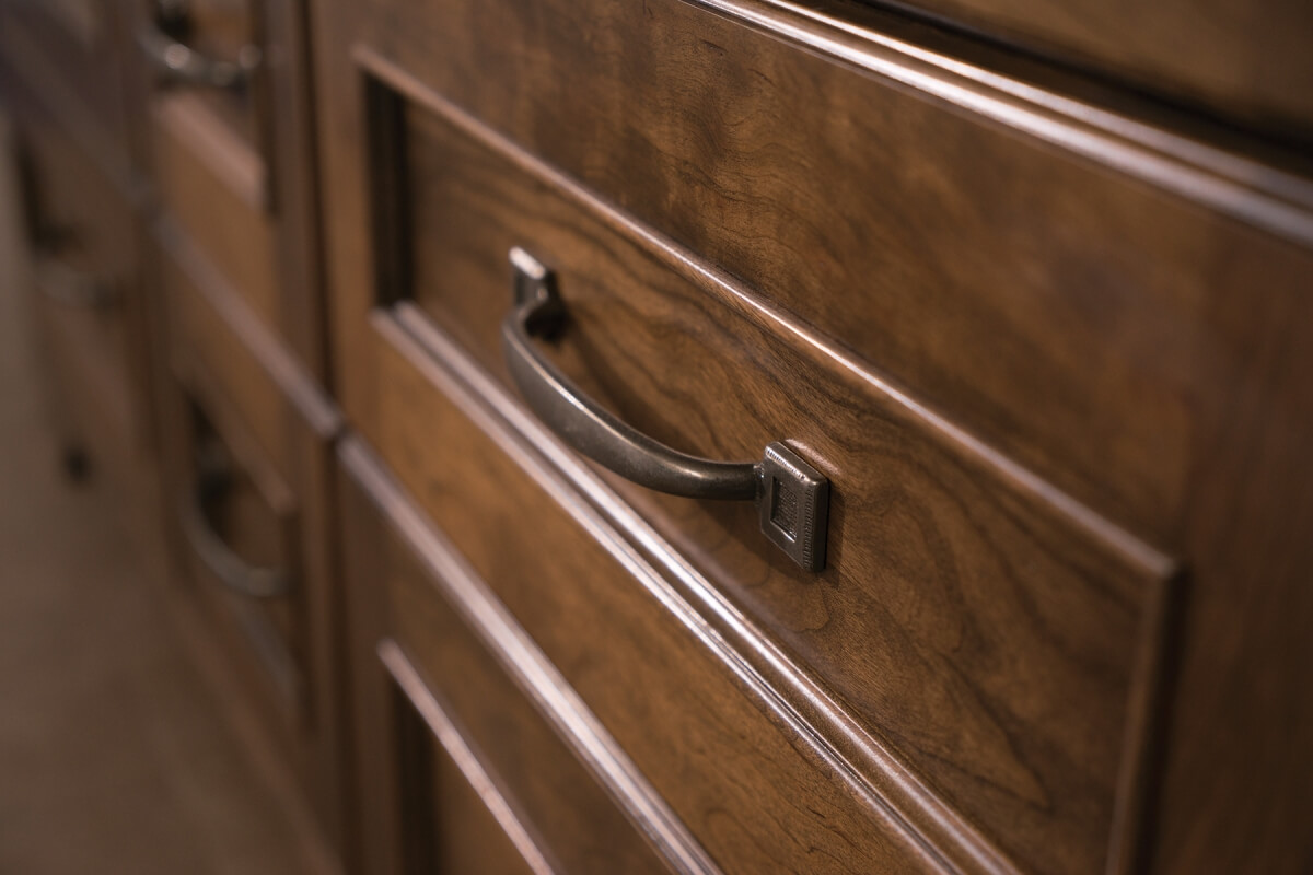 Close Up of Dura Supreme Stained finish on cabinet drawers.