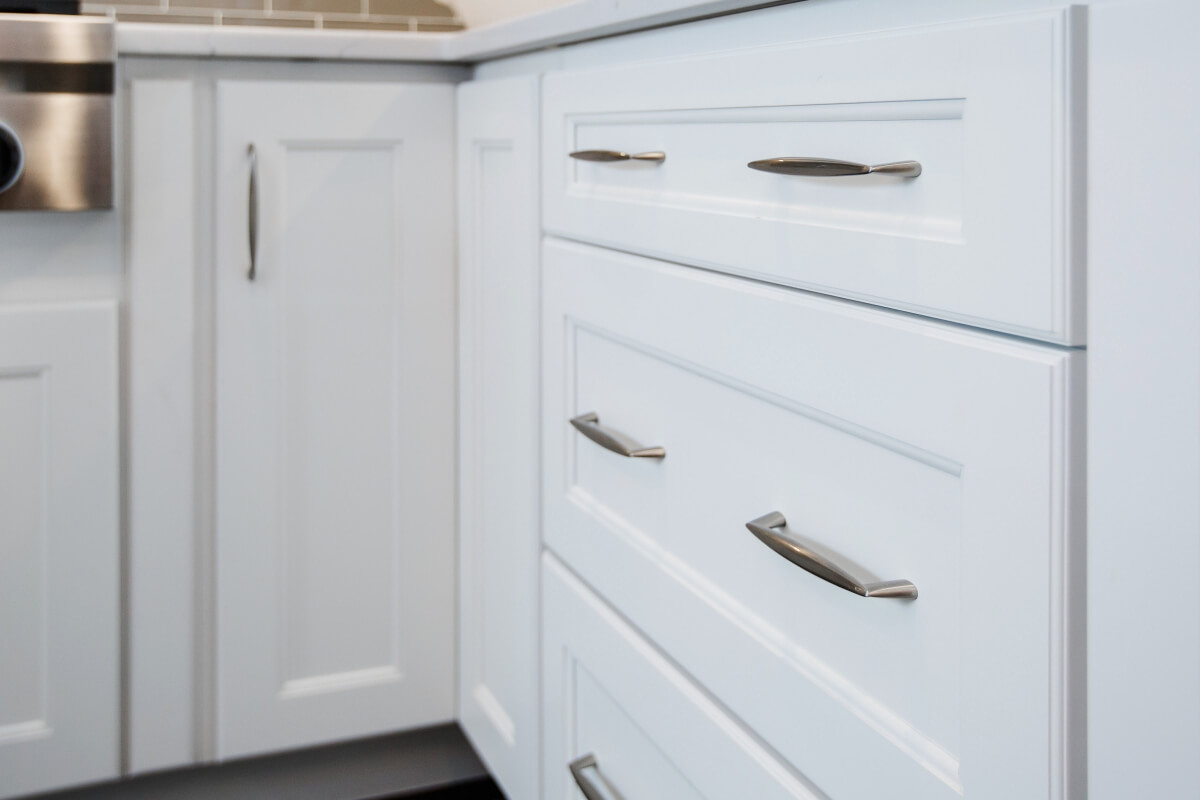 A close up of a corner cabinet door in a Dura Supreme kitchen.