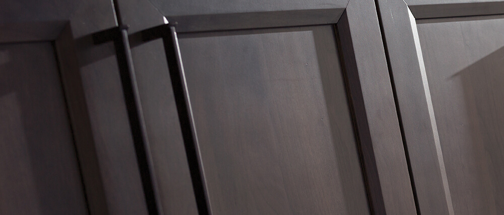 A close up of a Stain and Glazed cabinet finish on Cherry wood. Beautiful cabinet finish options by Dura Supreme Cabinetry.