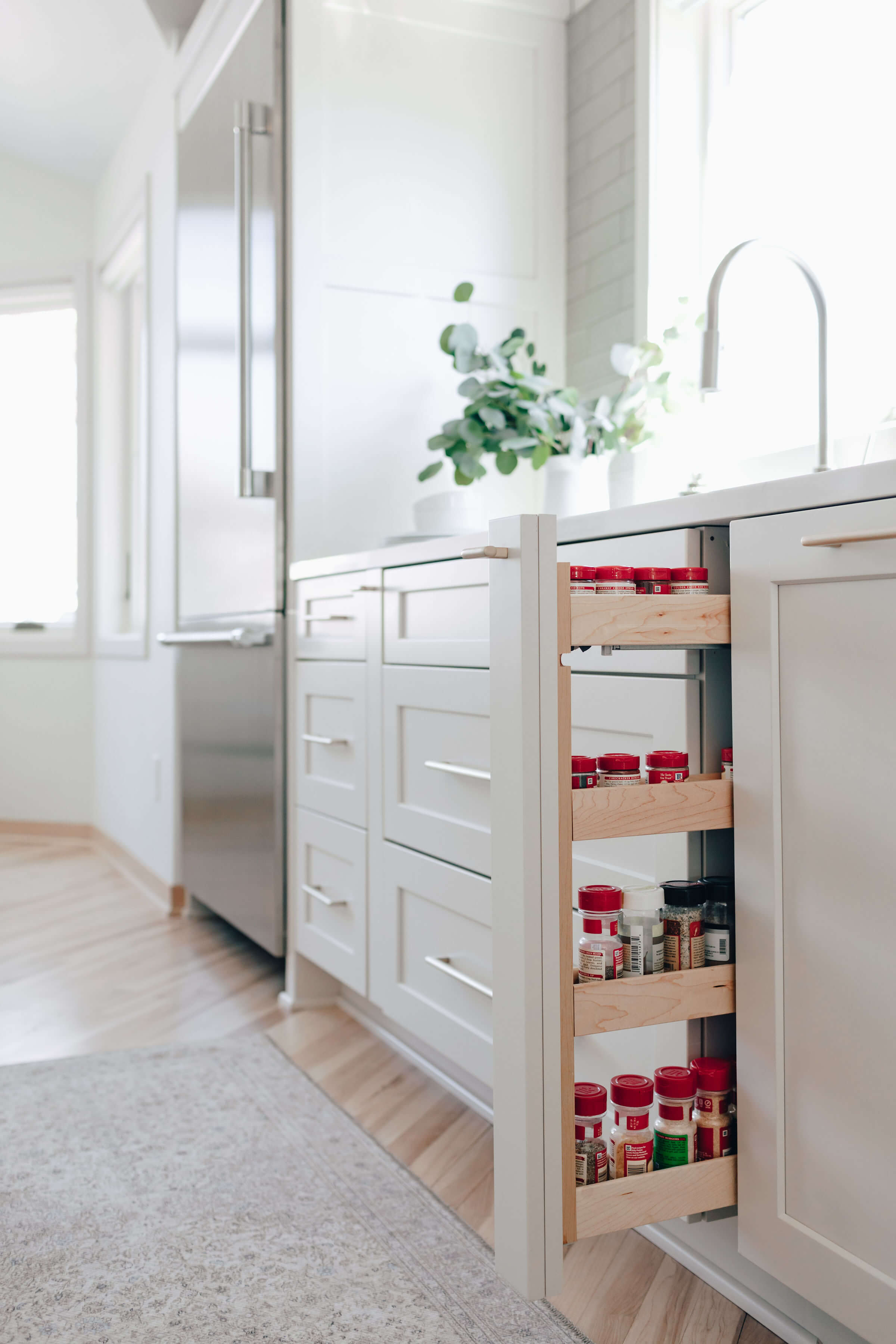 Dura Supreme's Pull-Out Spice Rack. Design by Danielle Lardani of Studio M Kitchen & Bath, Twin Cities, MN. Photo by Chelsie Lopez Production & Marketing.