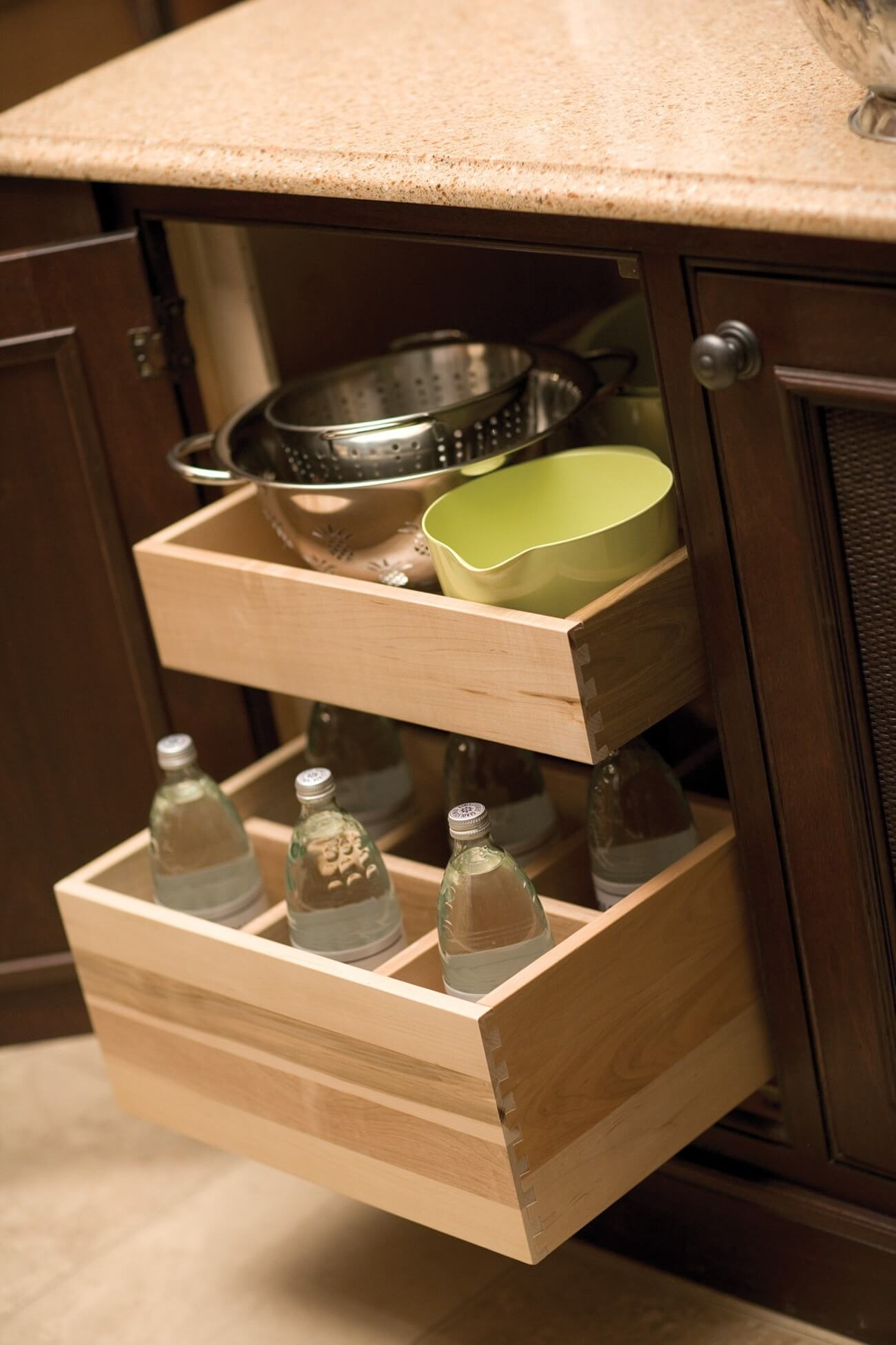 Roll-Out Bottle Rack by Dura Supreme Cabinetry with a Roll-out shelf above.