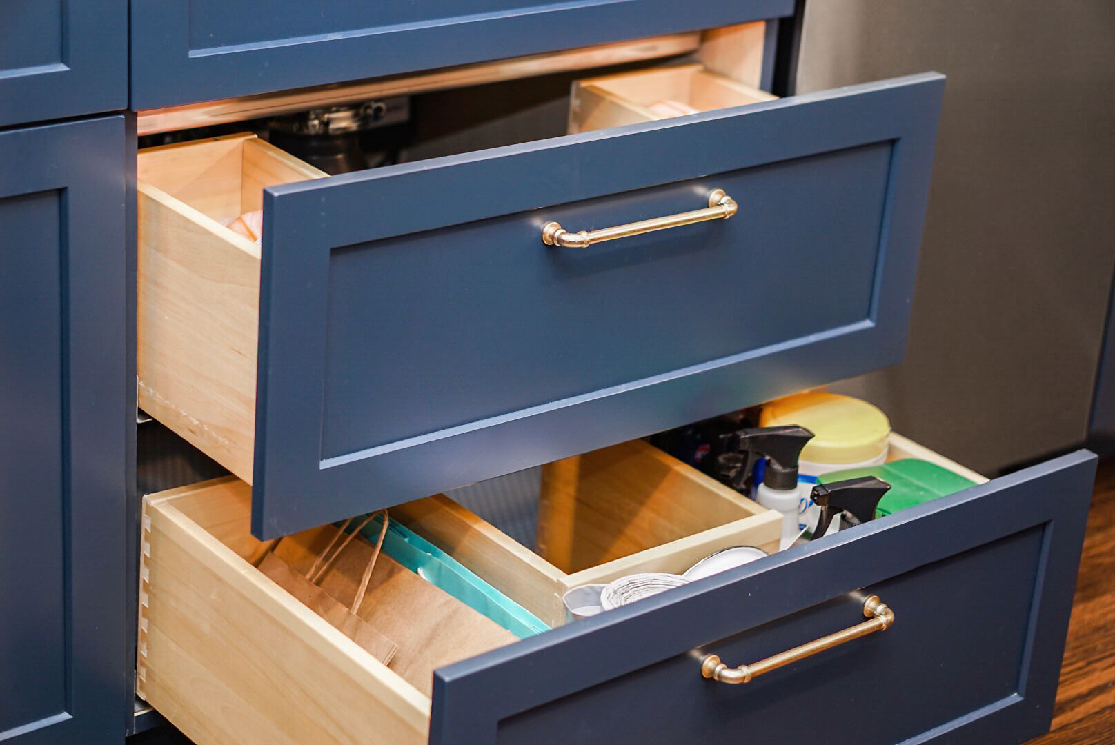 The custom sized plumbing drawers to fit around the garbage disposal and plumbing fixtures.